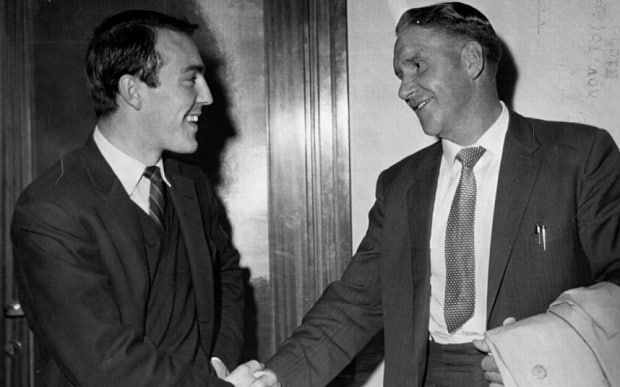 Tottenham Hotspur sign Jimmy Greaves, who shakes hands with manager Bill Nicholson