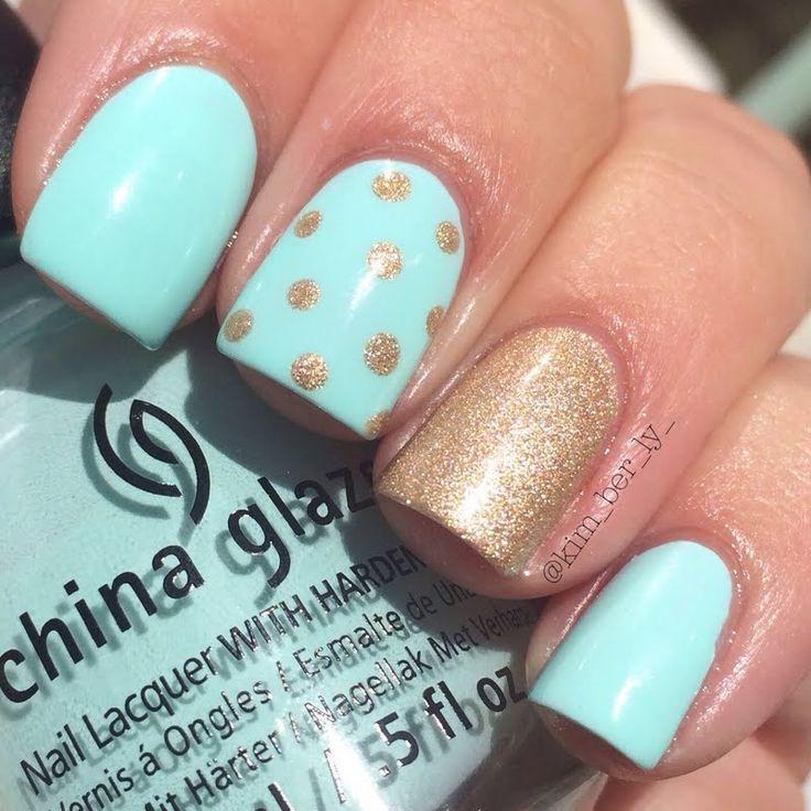 manicure -                                                      Easy on the eyes, pastel blue nail polish is complemented by a gorgeous sparkling polka dotted gold for accent. Recreate this manicure with the help of these products used.