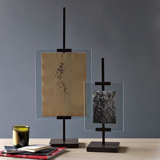 Tabletop easel picture frames. They compliment the giant floor easel frame and carry the theme throughout the room.