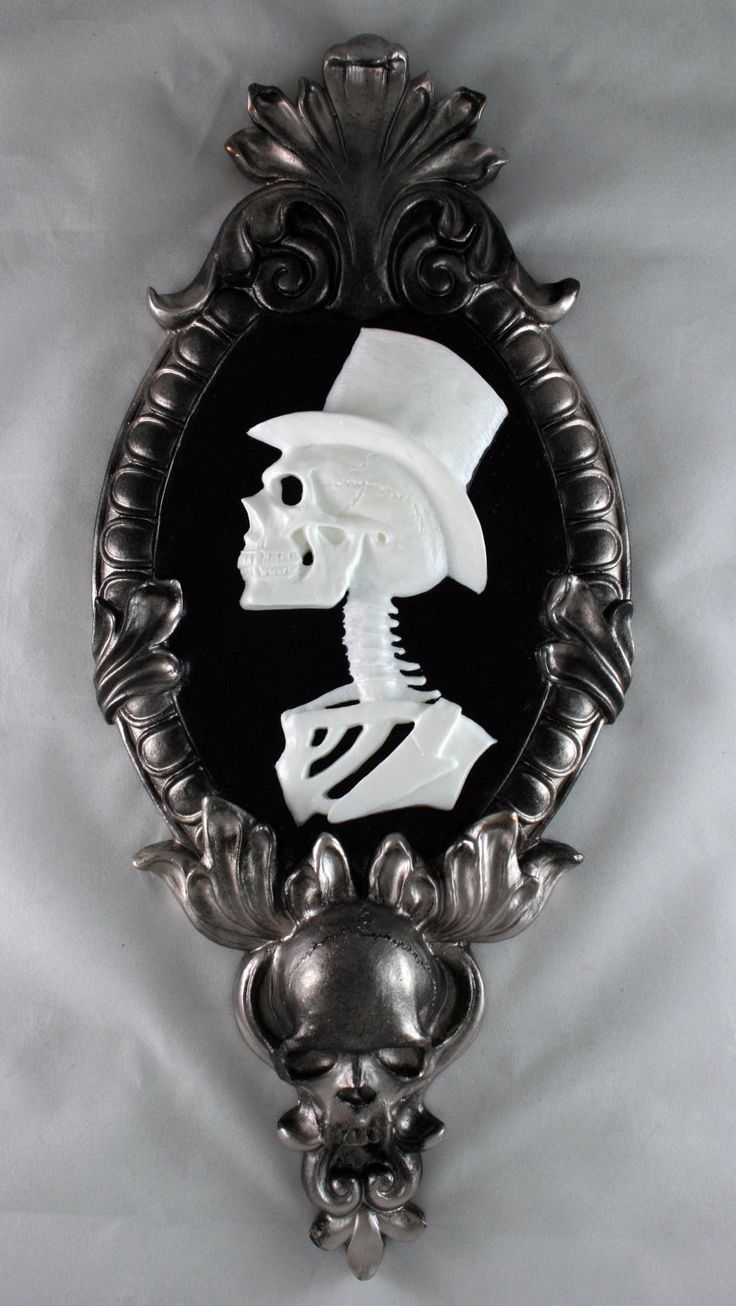 Gothic Victorian Gentleman Skeleton Cameo in silver tone frame - Black Light reactive by NecroticCreations on Etsy https://www.etsy.com/listing/170267982/gothic-victorian-gentleman-skeleton
