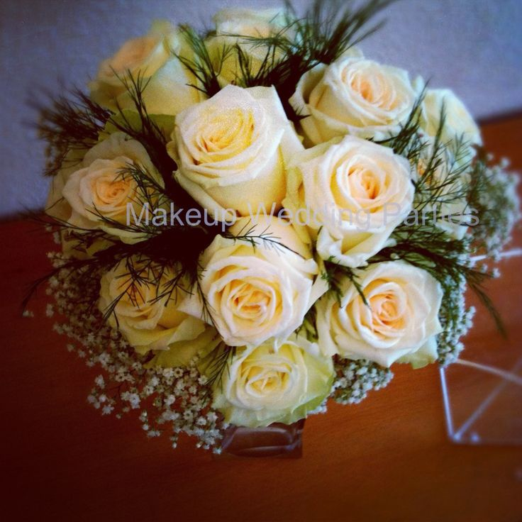 Roses, baby breath and greenery bouquet