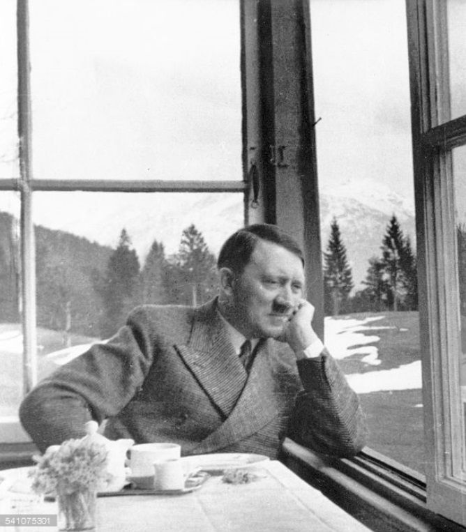 April, 1935. Eva Braun is sitting next to him here outside of Garmisch-P., but Hoffmann cropped her out. This is Hitler searsucker suit, which he wore not a all after 1936. The wide lapels were very fashionable at that time.