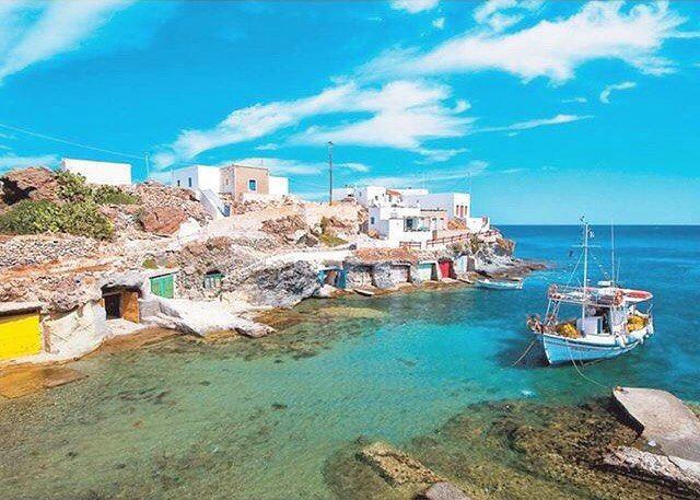 The small picturesque fishing bay called Goupa , at Kimolos island (Κίμωλος) . Wonderful shades of blue sea & sky .