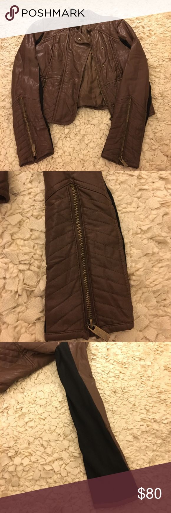 Bebe brown leather jacket This is a Bebe brown zip up leather jacket with black accent sleeves. It is a center zip with two front zipper pockets. It is also gently worn. bebe Jackets & Coats