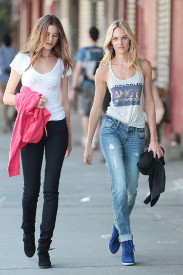 Behati Prinsloo in black skinnies with Candice Swanepoel in ripped light-washed jeans