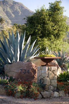Love the street numbers on the boulder - Mediterranean Garden