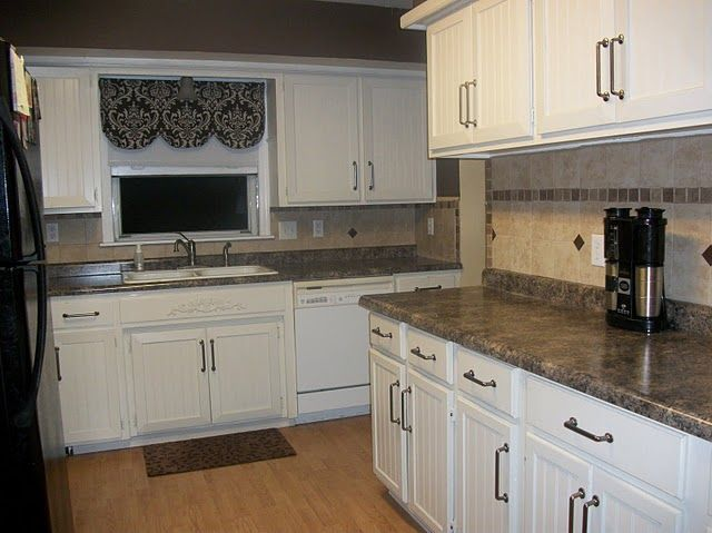 Kitchen remodel on a budget i 39 m likin 39 the white cabinets for How to redo your kitchen