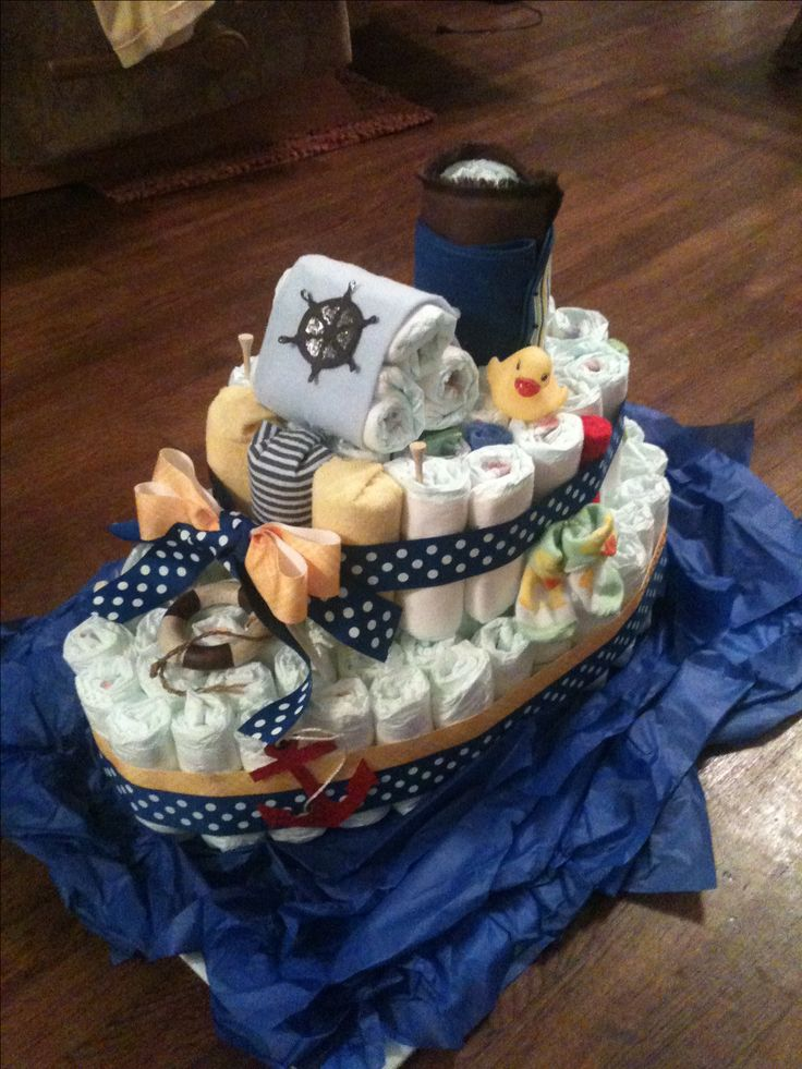 "Nautical theme.  My first diaper ""boat"" cake. A fun break from traditional diaper cakes."