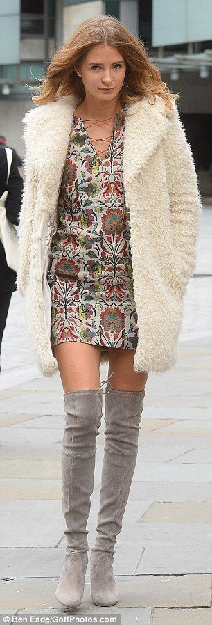 Sexy: The 26-year-old channelled a vintage style in a patterned mini dress which had a plu...