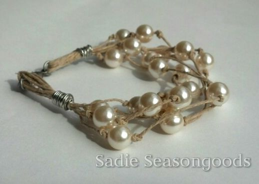 Use thrift store pearls and reimagine them with hemp cord to create summer jewelry with a beach-y feel!