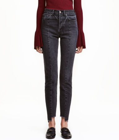 Black washed out. 5-pocket, ankle-length jeans in washed denim with distressed details. High waist. Straight legs with seams at front and back and uneven,