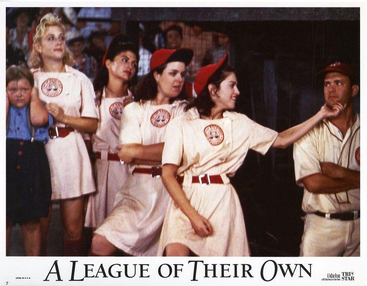 """A League Of Their Own"" lobby card, 1992.  L to R: Justin Scheller, Bitty Schram, Tracy Reiner, Rosie O'Donnell, Madonna, Tom Hanks."