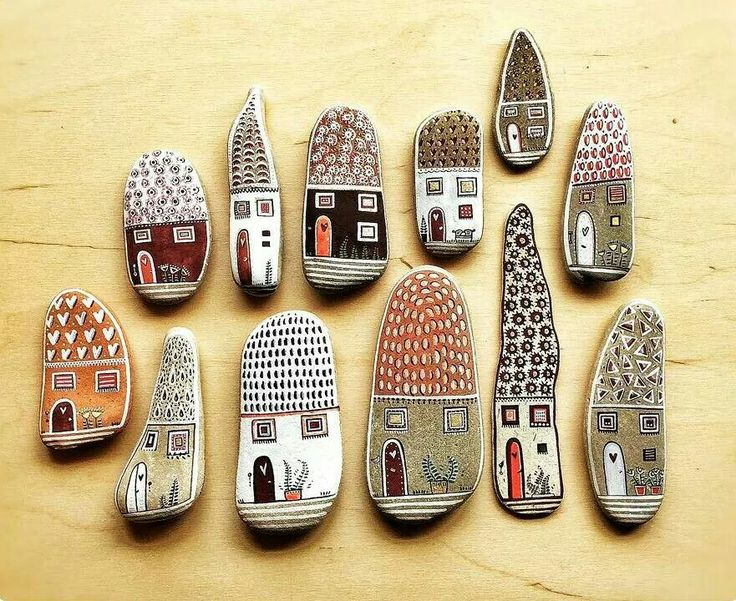 Painted pebble art houses                                                       …