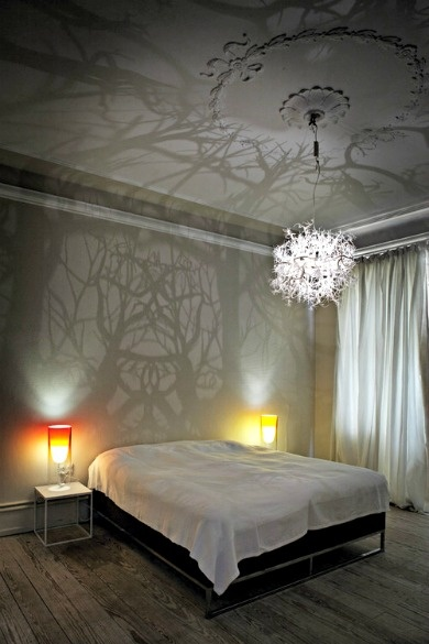 Love the way the chandelier shines a forest shadow on the wall...