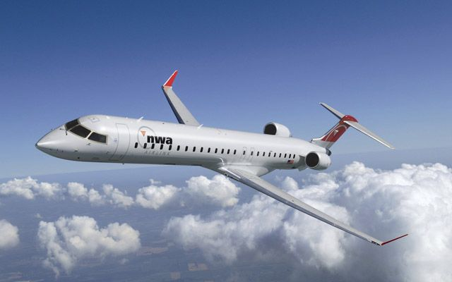 The Bombardier CRJ900 manufactured by Bombardier Aerospace is a Canadian regional airliner aircraft. The CRJ900 is loosely based on the CRJ200 series with a few major improvements. The CRJ900 can be configured to accommodate 79 passengers in dual-class seating, 88 passengers in a single class seating or 90 passengers in a high density configuration.