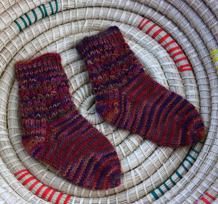 handmade by stefanie: FO Friday: Small Things Are No Sweat. Sweetest Baby Socks pattern is new and improved! Shown here knit in a new exclusive base of yarn available at A Good Yarn Sarasota called A Good Yarn Fingering.