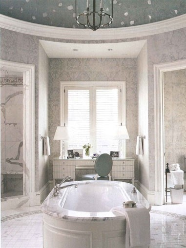 Circular bathroom with large oval tub and domed ceiling (AD)