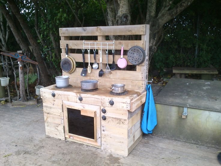 Sand pit kitchen.  Stove and oven made out of pallet