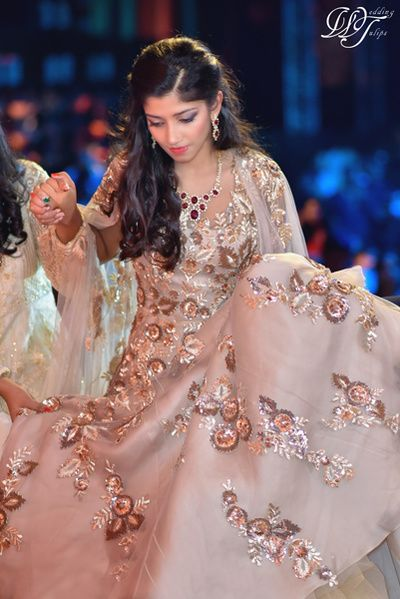 Cocktail Outfits - Beige Gown with Gold and Bronze Flower Embroidered Motifs | WedMeGood #indianwedding #indianbride #gown #cocktail #beige