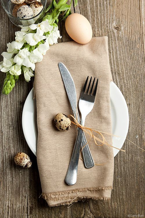 Easter decoration, dining room table with eggs and flowers