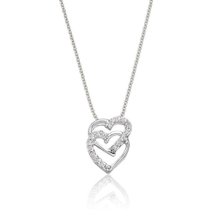 This elegant white gold diamond pendant has 0.07ct diamonds. The pendant features two interlocking hearts designed to give a beautiful contrasting finish. Each of the 2 hearts are part polished and part encrusted with round brilliant cut diamonds. This necklace is made in 9K white gold and is available complete with a beautiful mirror trace chain or if you already have a chain then you have the option to buy just the pendant.