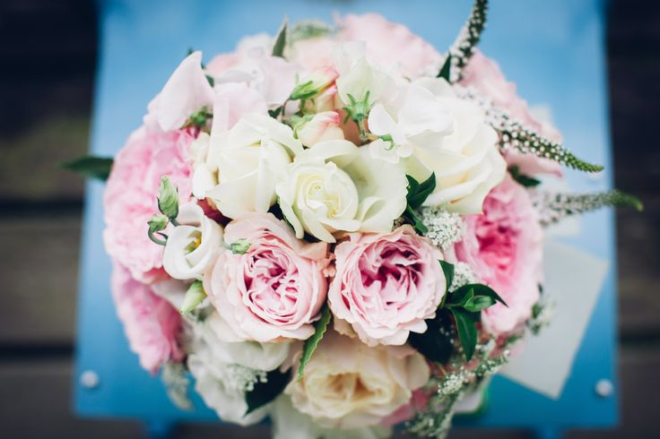 Bride's bouquet - pink and white roses with sweet peas and greenery