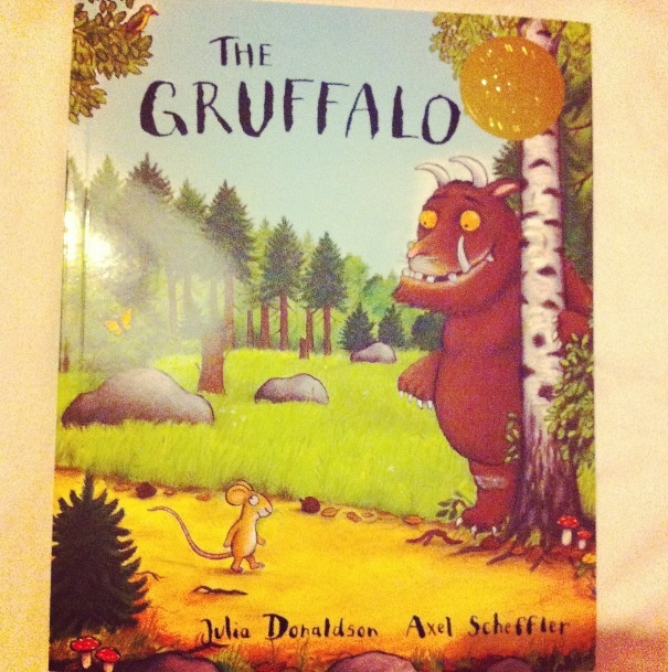 'The Gruffalo' by Julia Donaldson. The story follows a mouse as he makes his way through the woods, tricking other animals and ultimately tricking the Gruffalo. The book encourages children to join in, as the lines follow a similar rhyming structure throughout the book.