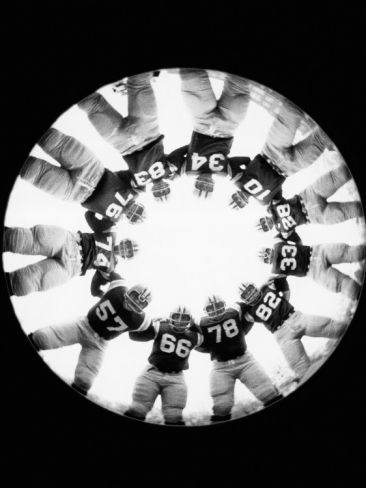 Football Huddle Photographic Print by H. Armstrong Roberts at Art.com
