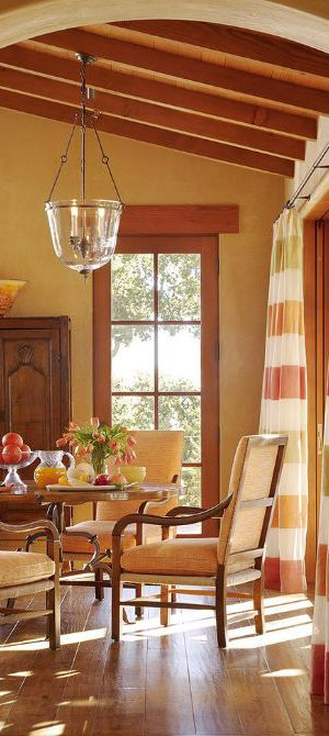 I love the warm, earthy tones with those drapes!  Great furniture and lighting fixture, too! Shippmann Design | Mediterranean Dining Room