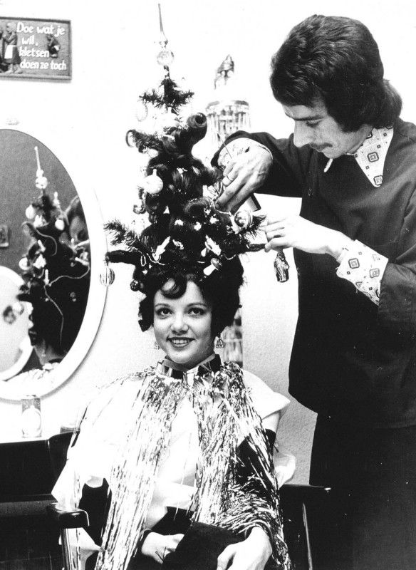 Vintage Christmas tree hair style complete with ornaments and lights. By Dutch hairstylist Frans Van Oers. Early 70s.