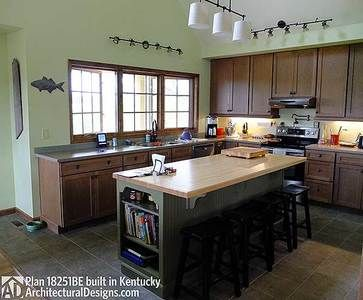 <ul><li>Porches, decks and a pergola add outdoor living space to this adorable Cottage home plan.</li><li>A big, open floor plan unites the kitchen, living room with fireplace and dining room with its sliding glass doors to the outdoor dining porch. The living and kitchen ceiling vaults to a peak of 19' which is carried through to the loft overlook.</li><li>The master suite has two sets of triple windows to bring in light.</li><l...