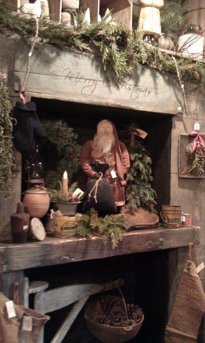 Prim Cupboard...filled with old santa & pine for Christmas.