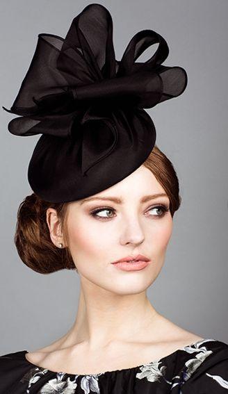 Rachel Trevor Morgan, S/S 2014. Silk organza pillbox with organza bows.Love the makeup, hair and headpiece.