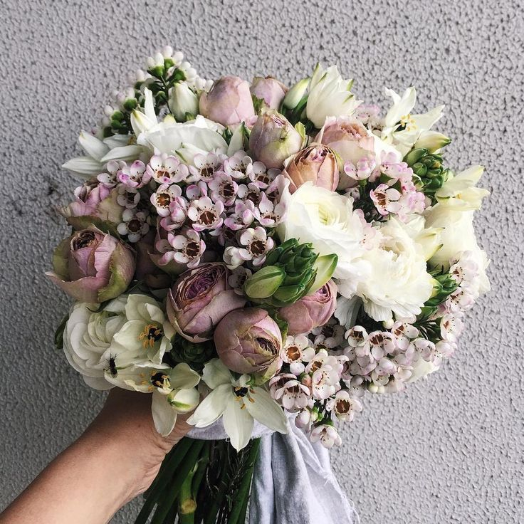 Vintage pink and white wedding bouquet: roses, eat flower, arab eyes and ranunculus  By @dittodittoflorals
