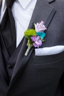 David Corey Photography purple, blue and green boutonniere captured by David Coey Photography | As seen on TodaysBride.com