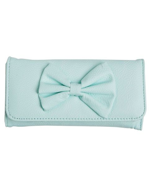 "With some girly flair, this long, fold-down wallet is very cute! Designed in faux leather, it features an adorable big bow decorating the front flap that snaps closed. When unfolded, inside are several pockets, including a zippered coin pocket and 10 card slots.      6.5"" Length x 3.25"" Height x 1"" Width     Man Made Materials     Imported"