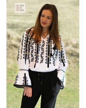 inspiration in fashion - hand embroidered Romanian top that inpires the designers of the world.