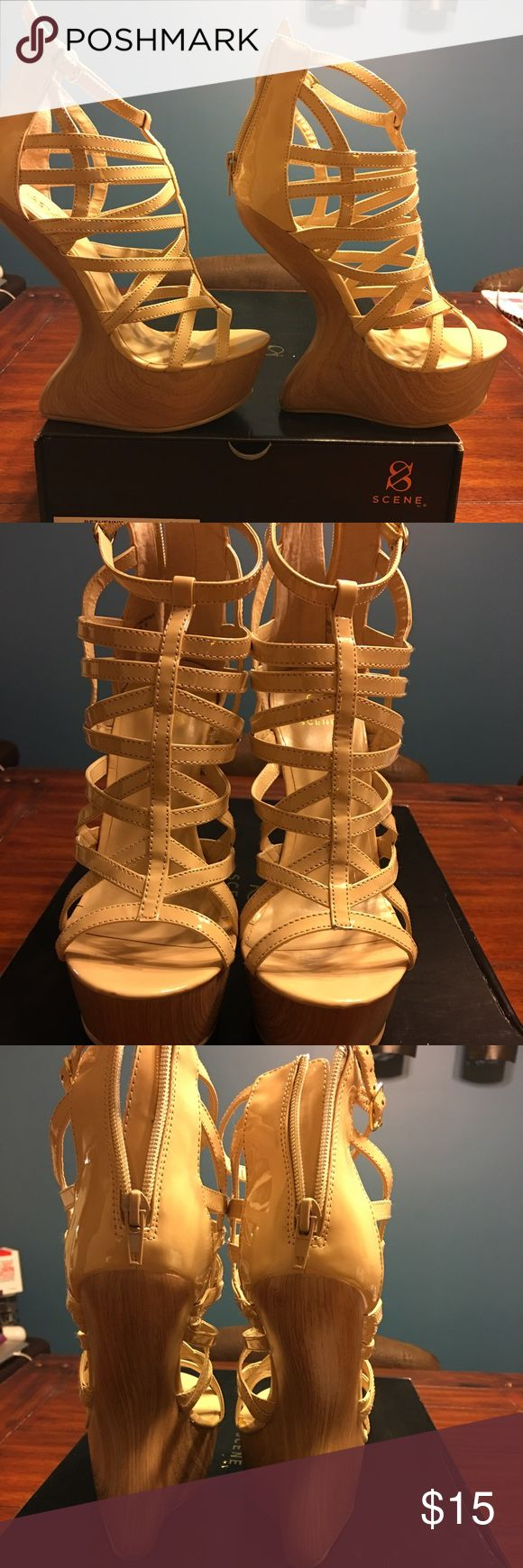 """Unique """"No Heel"""" Platform Shoes Get in touch with your inner Lady Gaga in these shoes. Bought from Shoe Dazzle. Beige leather with no heel illusion. Only worn twice. Very sexy on! Shoe Dazzle Shoes Wedges"""