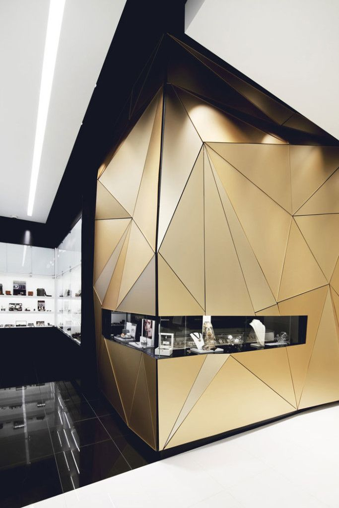 Interior Architecture: beautiful gold faceted front window of  Boutique Penelope by Hatem+D