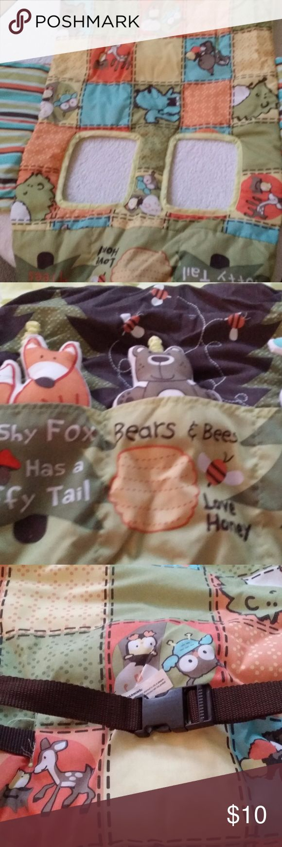 Woodland Friends Shopping Cart Cover Shopping cart cover to protect your little one from germy and grimey shopping carts. Cover drapes over the four sides of the cart and secures with velcro. Stuffed owl, fox and bear provides your little one entertainment while you get your shopping done. When not in use, the stuffed animals slide right into their little pocket home. Comes with nylon strap with buckle to secure your little one in the shopping cart.  Has been used and washed several times…