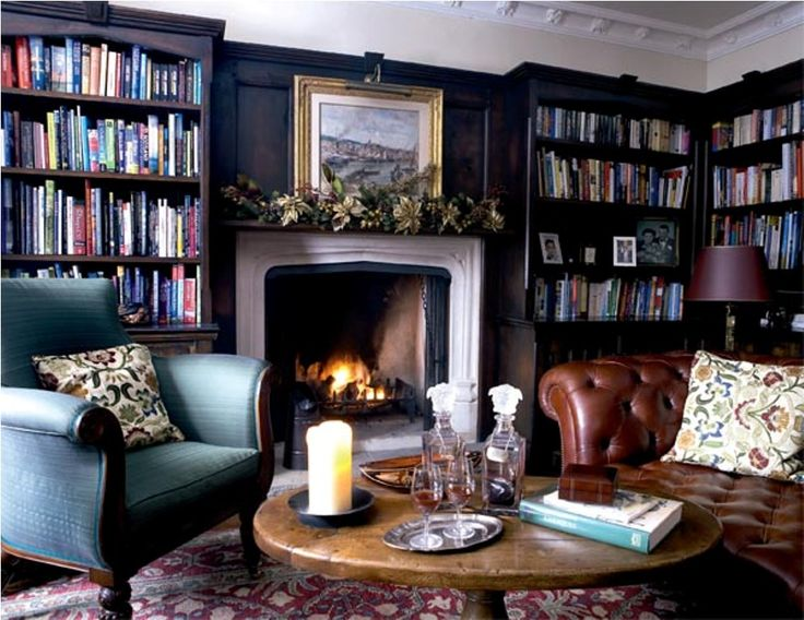 The chesterfield leather sofa in the library is from George Smith; the chair covered in horsehair fabric is from johnboydtextiles.co.uk.