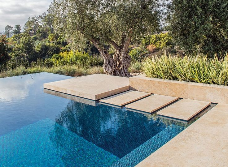 Perimeter overflow pool with floating steps pinnacle for Garden pond overflow design