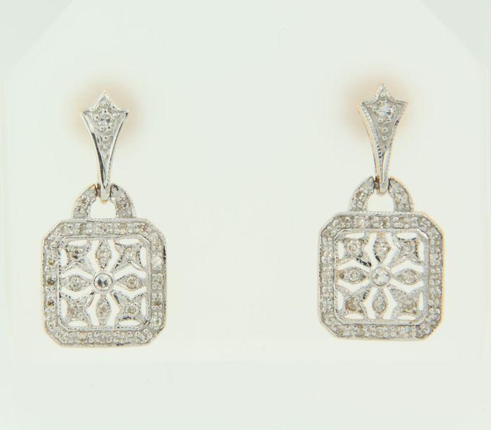 Online veilinghuis Catawiki: bicolor gouden oorhangers bezet met 8 kant geslepen diamanten