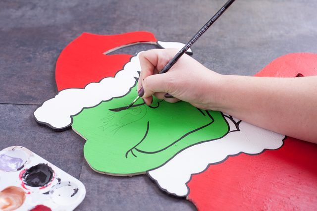 While wood cutouts make popular lawn fixtures during the holiday season, they are also expensive to purchase and often limited in selection. The Grinch, a much-loved Dr. Seuss character, is particularly difficult to find. However, Grinch fans can make their own decorative lawn ornament with a few supplies and a little bit of patience.