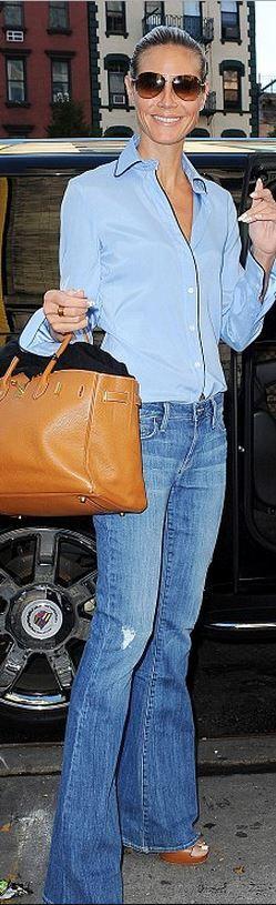 Heidi Klum, brown tote handbag, button down shirt, and blue flared jeans