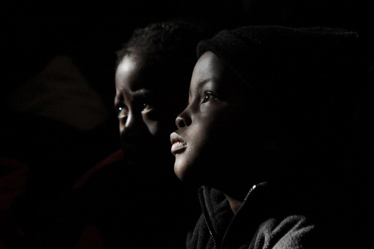 July 18, 2012. Children listen to the history of former president Nelson Mandela at the Melville Primary School as they join in celebrations of Mandela's 94th Birthday in Johannesburg. Denis Farrell—AP.