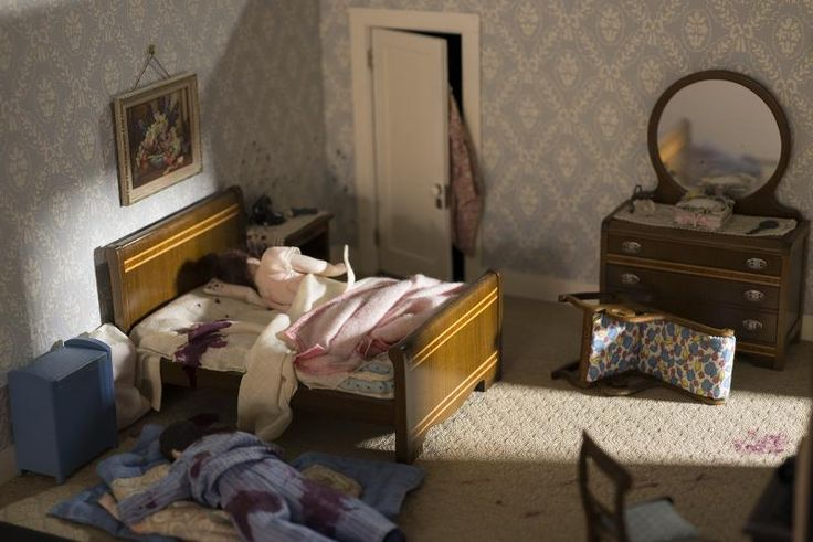 A photograph of a nutshell study of unexplained death showing a detail of a murder scene in a bedroom. (13 of 26)
