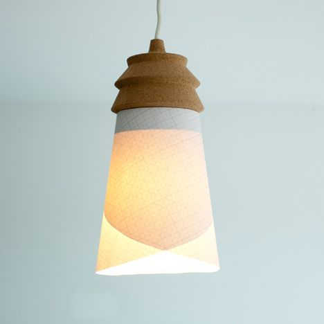 users can pin their own paper shades onto this cork light fitting - by Raw Edges for Materia.