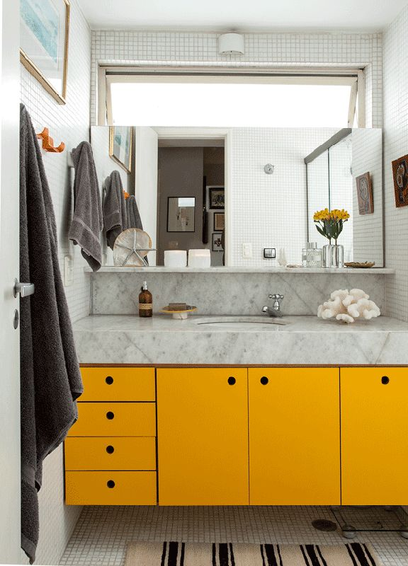 yellow cabinets in the bathroom to give it a pop of color #decor #banheiros #bathrooms
