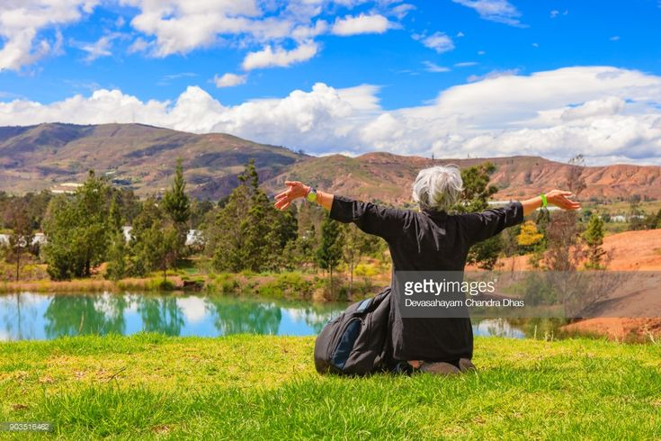 Stock Photo : Latin Lady With Silver Hair Celebrates The Beauty Of Nature In the Tranquil Surroundings Of The Pozos Azules Near The Town Of Villa de Leyva On The Andes Mountains In The Colombia Department Of Boyacá